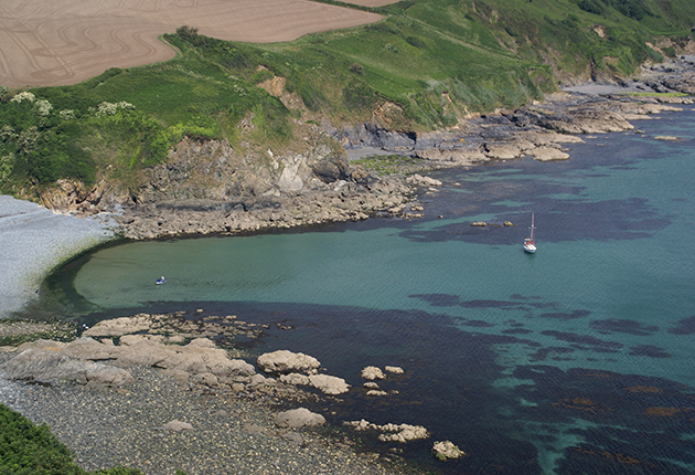 Yachts anchored at Porthallow beach