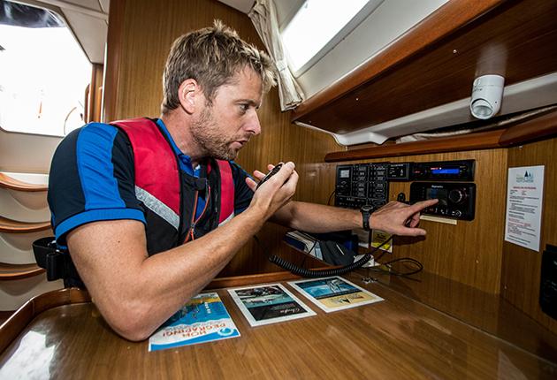 A skipper doing a radio check on a boat