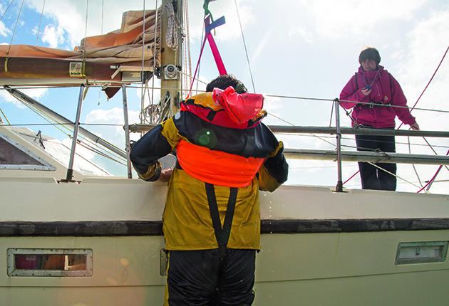A man overboard being recovered onto a yacht