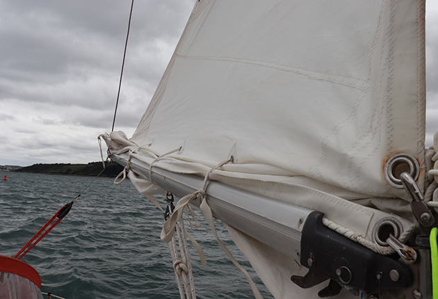A reefed main sail on a yacht