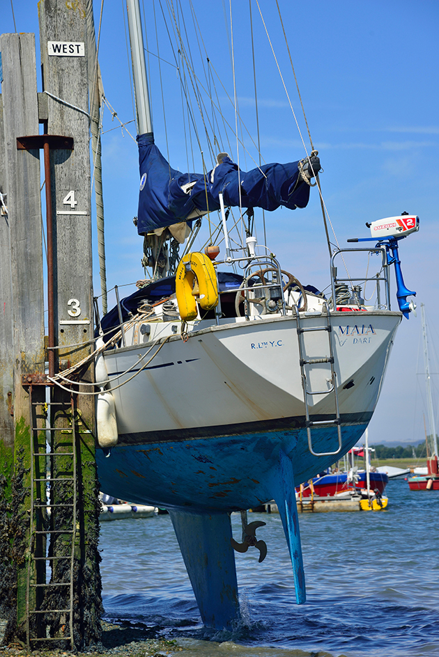 Using scrubbing posts is cheaper than lifting out, but makes it harder to antifoul safely and effectively