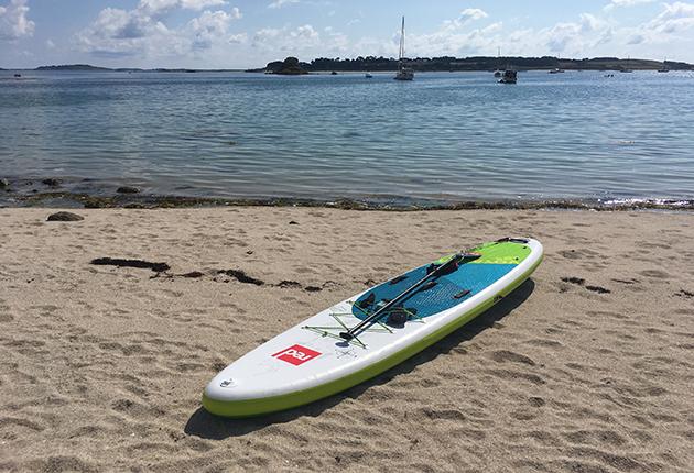 A paddleboard on a beach