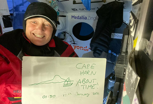 Pip Hare celebrating as she passes Cape Horn during the Vendee Globe yacht race