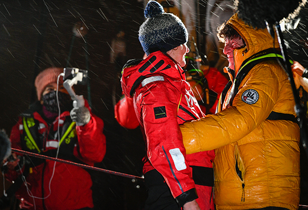 Pip Hare is hugged by Vendee globe veteran Jean Le Cam after finishing the 2021 race