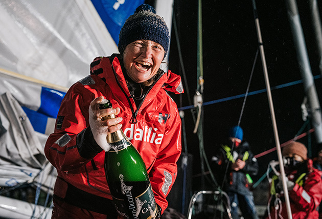 Pip Hare celebrates after crossing the finish line in the 2020-21 Vendee Globe