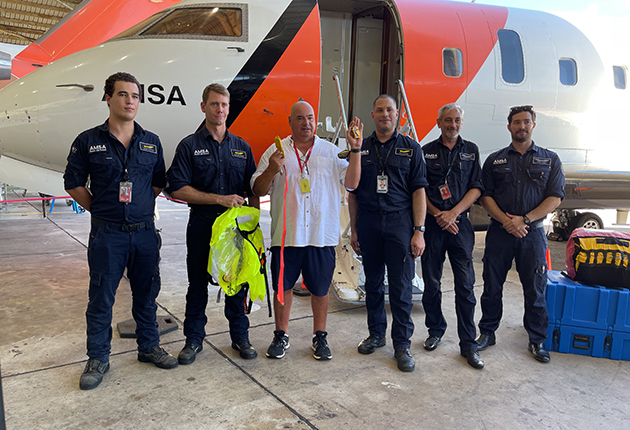 The crew of an AMSA aircraft with Nigel Fox who was saved by his PLB when he went overboard from his yacht