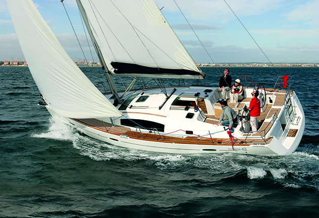 An ICC skipper at the helm of a yacht in Spain