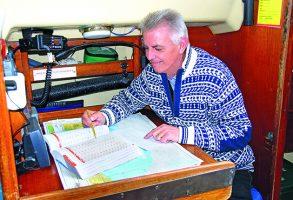 John Goode sitting at a chart table
