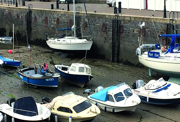Boats in a drying harbour in the UK