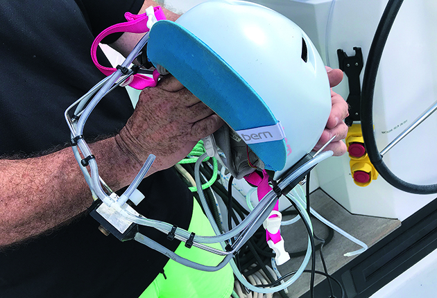 The boat can be controlled using a straw mounted on her helmet. The helmet controls are plugged in at either helm station and she can operate switches by sipping or puffing the straw