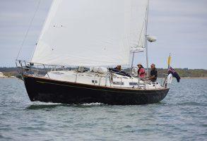 A skipper sailing in a breeze