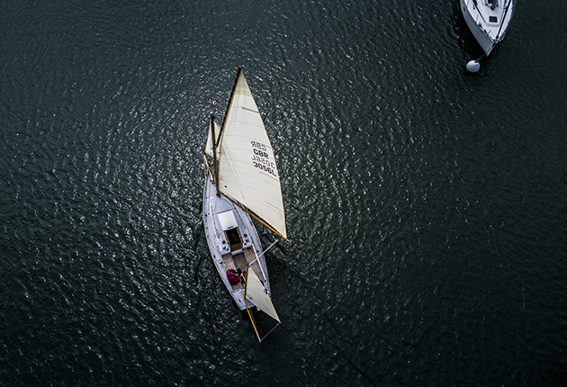 A picture of a yacht taken from a drone