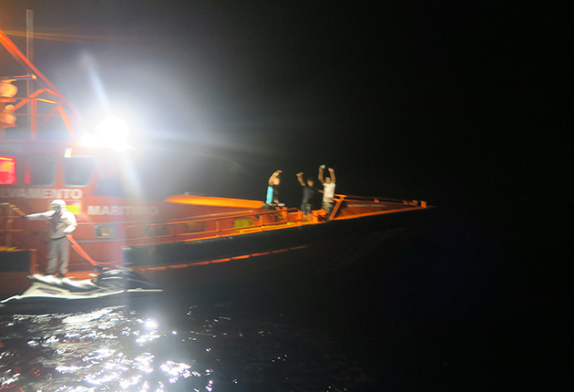Having called for assistance as spotting migrants at sea, Seren's crew watch as the crew of a het ski adrift in the Gibraltar Strait are rescued