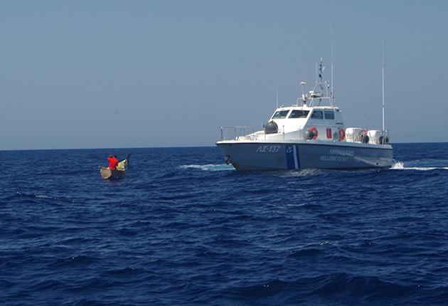 A coastguard boat rescuing migrants at sea