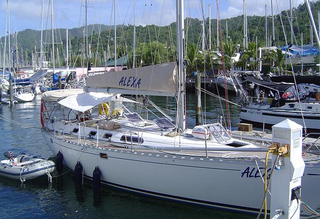 A yacht anchored at Coral Cove Marina in Trinidad