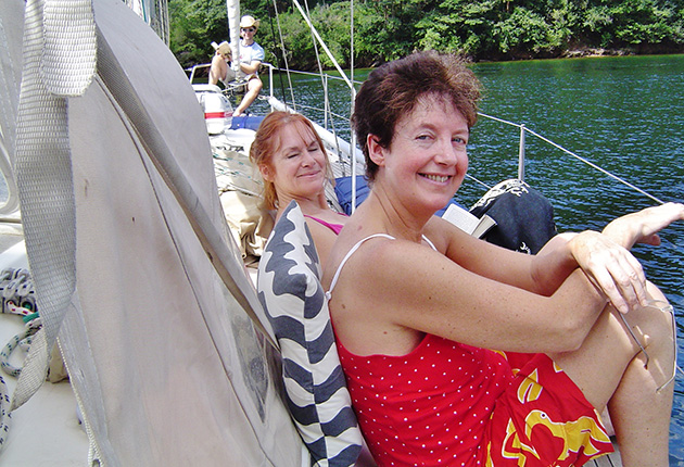 Women on a deck of a Dufour 41 in Scotland Bay in Trinidad