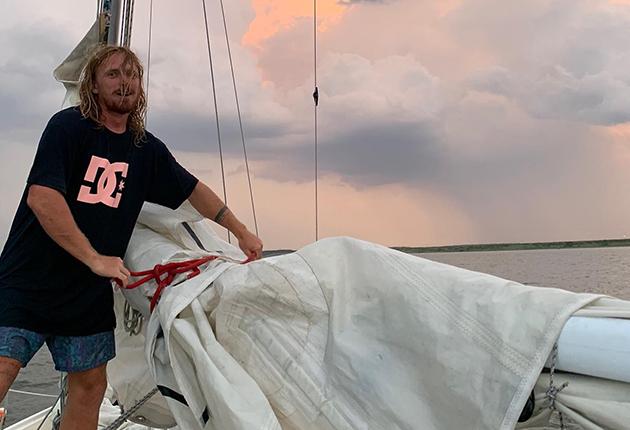 Elliott Smith bringing in sails on his boat