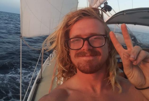 A skipper on a boat sailing