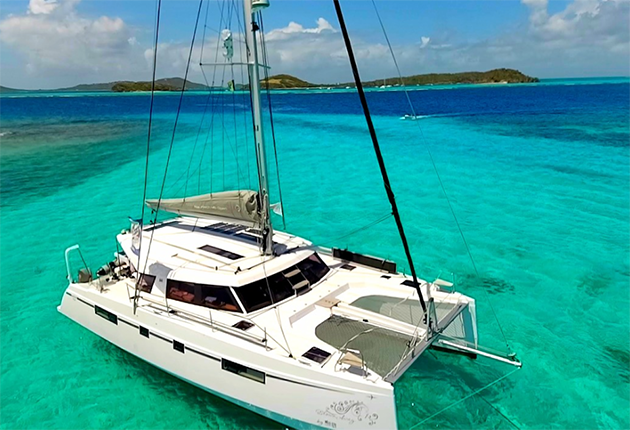 Natasha' father Gary converted the catamaran so it can be sailed conventionally and by sip and puff.