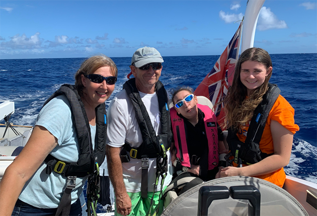 Natasha Lambert's family on board their catamaran, Blown Away