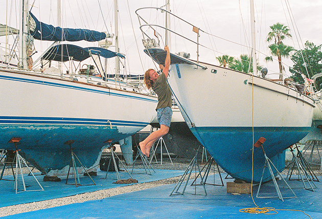 Elliott Smith hanging from the bow of his Gale Force 34