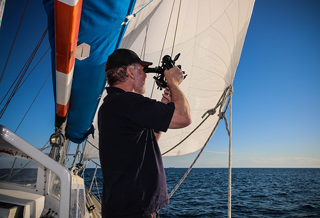 Mark Sinclair navigating by sextant