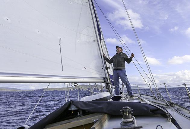 Pat Lawless looking at his sails