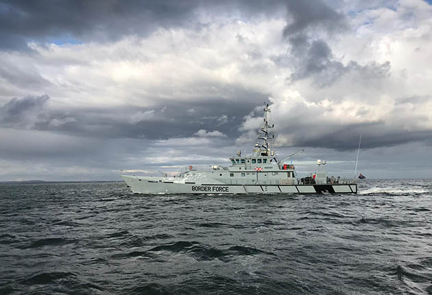 Seeker, the Border Force cutter overshadowing Vantage in the southeast of the Isle of Wight