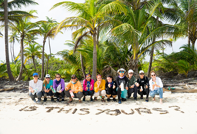 A group of women having just done a beach clean