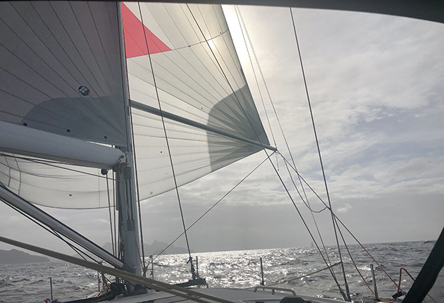 Keep the spinnaker pole horizontal and roughly in line with the boom when downwind sailing