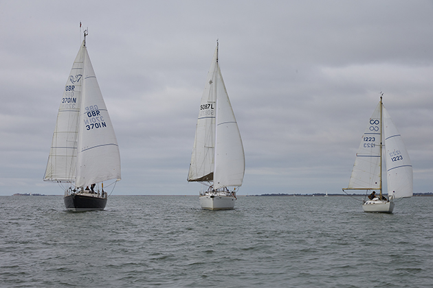 In light airs, good sail shape and minimal drag become more important than boat speed. Credit: Graham Snook
