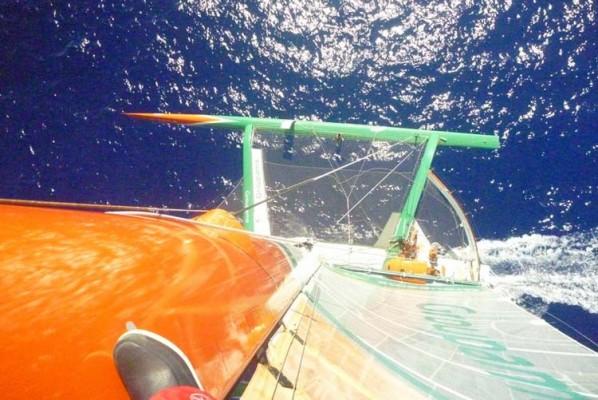 Groupama 3, crewman up the mast