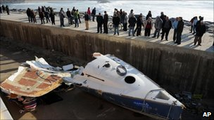 wreckage of boat hit by wave