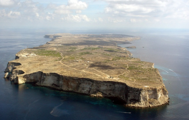 The island of Lampedusa, largest island of the Italian Pelagie Islands in the Mediterranean Sea as seen from the air.