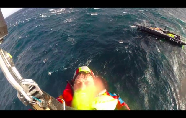 Alex Thomson winched up to a Spanish Coastguard rescue helicopter