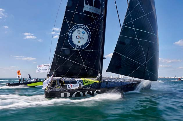 Hugo Boss finishes third in Les Sables d'Olonne at the end of the 3100-mile New York-Vendee single-handed transatlantic race. credit Thierry Martinez