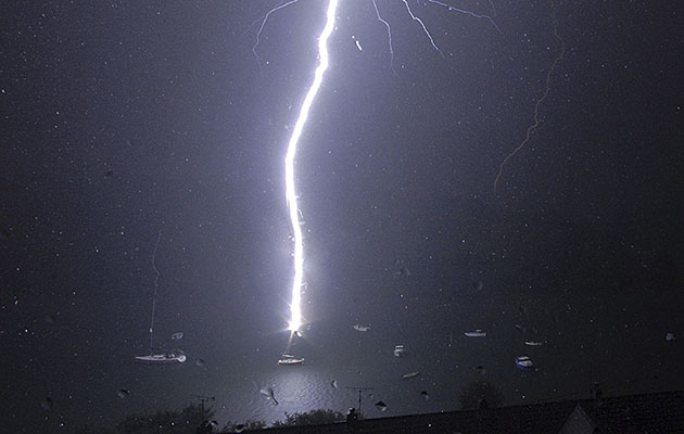 A moored yacht gets zapped by a bolt of lightning Pic: APEX News and Pictures