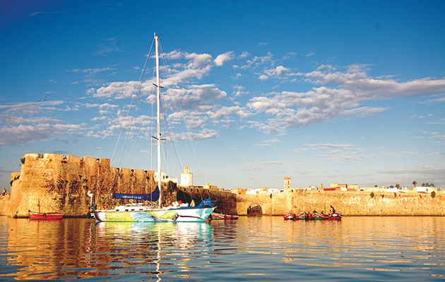 A winter adventure: yacht Hummingbird moored just off the old Portuguese fortifications of El Jadida