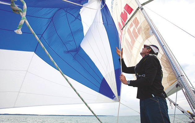 Hoisting a spinnaker short-handed is an exercise in communication and methodical preparation.