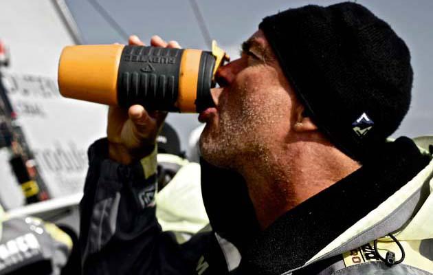 January 23, 2015. Leg 3 to Sanya onboard Team Brunel. Day 20. Skipper Bouwe Bekking avoiding dehydration.
