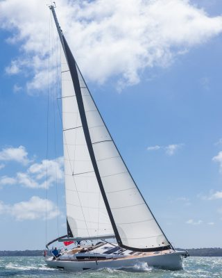 Dufour-56-exclusive-boat-test-running-shot-tall-credit-david-harding