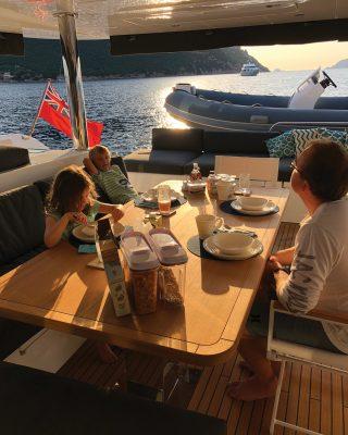 sardinia-charter-catamaran-lagoon-620-aft-deck-breakfast-credit-helen-fretter