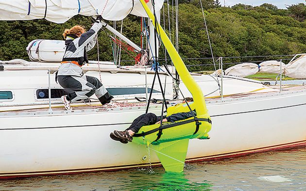 Hoisting a casualty aboard using a Jonbuoy inflatable man overboard raft