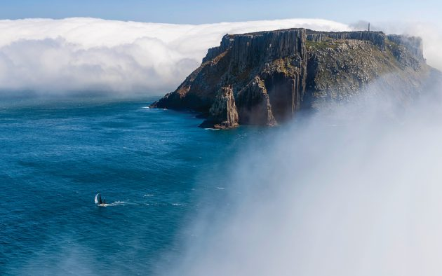The 1904 ketch Katwinchar rounding Tasmania's Cape Raoul. Photo: Carlo Borlenghi / Rolex