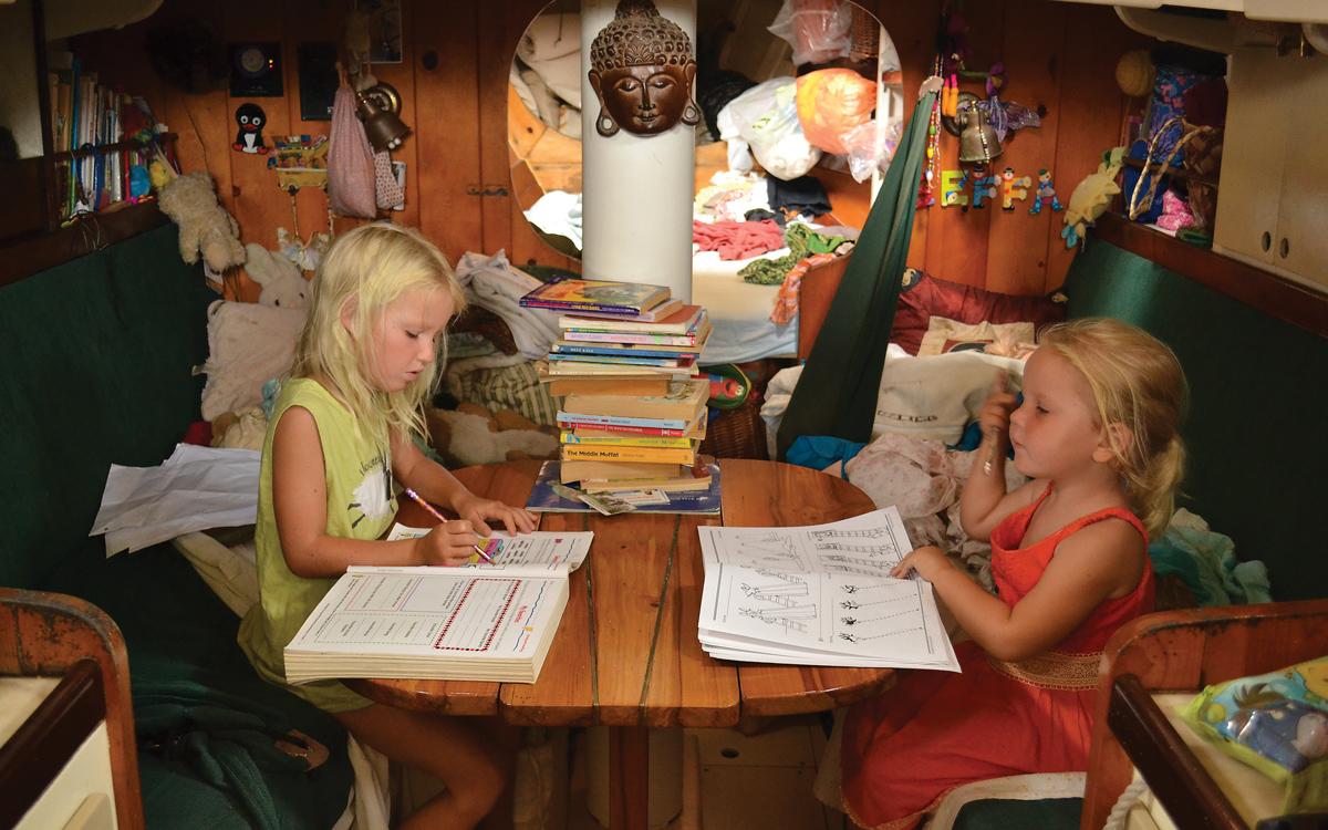 home-schooling-at-sea-workbooks-credit-Bruce-Halabisky