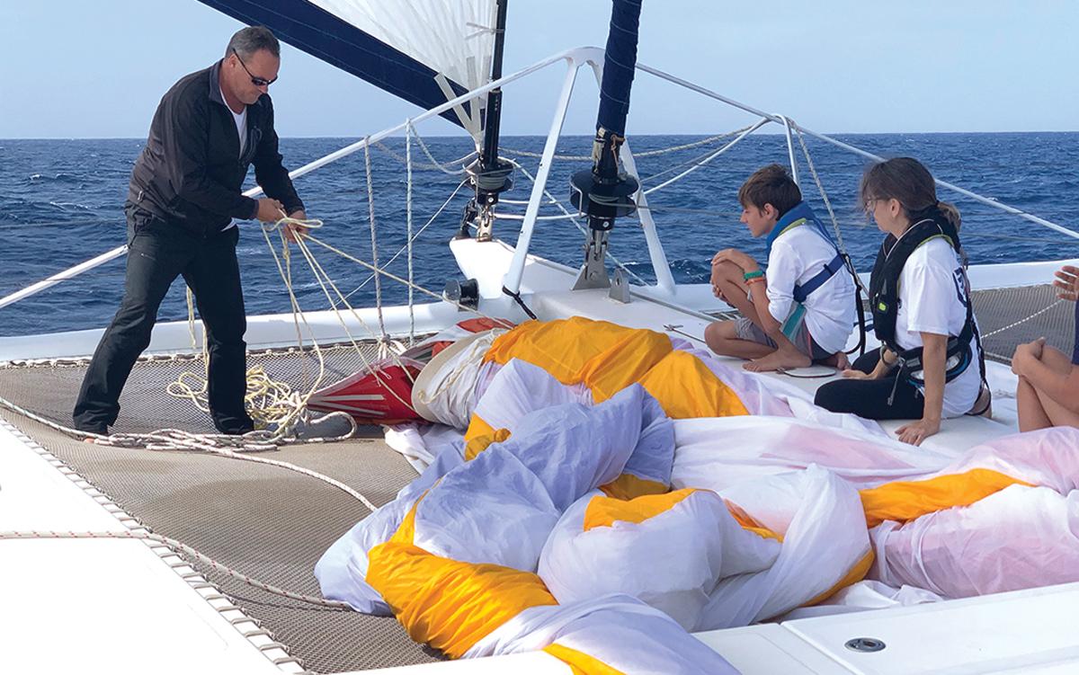 2019-arc-survey-sail-handling-Catana-65-foredeck-credit-Steve-Frary
