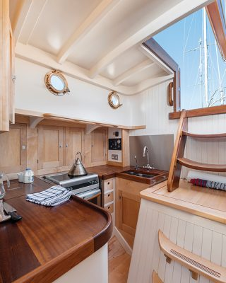 modern-classic-charter-yacht-helena-galley-credit-Richard-Downer