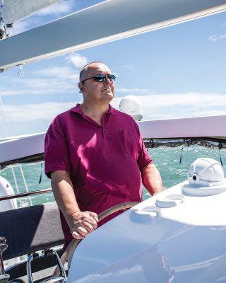 Discovery-Bluewater-50-catamaran-boat-test-owner-Werner-Schnaebele-helm-credit-Richard-Langdon-Ocean-Images