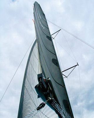 mainsail-handling-multihull-catamaran-sailing-techniques-Dragonfly-40-leech-credit-Al-Wood