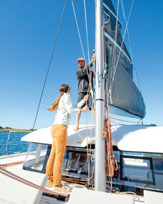 mainsail-handling-multihull-catamaran-sailing-techniques-Excess-15-coachroof-credit-Christophe-Launay